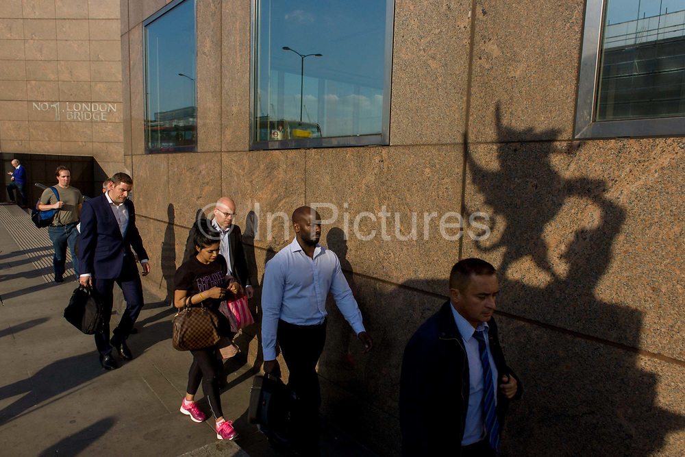 Commuters crossing London Bridge pass a City of London boundary griffin, on the southern Southwark bank of the Thames. The griffin statue marks the southern boundary between Southwark on the south side and the City of London beyond on the bridge. The City of London is a geographically-small City within Greater London, England. The City's boundaries have remained constant since the Middle Ages but it is now only a tiny part of Greater London. The City of London is a major financial centre, often referred to as just the City or as the Square Mile, as it is approximately one square mile (2.6 km) in area. London Bridge's history stretches back to the first crossing over Roman Londinium, close to this site and subsequent wooden and stone bridges have helped modern London become a financial success.
