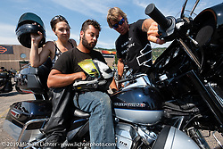 Harley-Davidson employee Mike Klawiter helped Mark Shipman and Sarah Speratos of Phoenix, AZ with an Ultra Limited Low at the Harley-Davidson test rides out of the Sturgis Civic Center on Lazelle during Sturgis Black Hills Motorcycle Rally. SD, USA. Thursday, August 8, 2019. Photography ©2019 Michael Lichter.