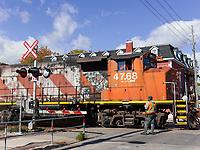 https://Duncan.co/engineer-guiding-locomotive-through-intersection