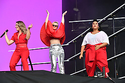 Singers Kirsten Joy (left) and Yasmin Green (right) perform with Grace Chatto of Clean Bandit during the first day of BBC Radio 1's Biggest Weekend at Singleton Park, Swansea.