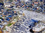 """Nederland, Noord-Holland, Broek in Waterland, 13-02-2021; door de strenge winter is ook Het Havenrak dichtgevroren. Schaatsers  leven zich uit maar het ijs is van matige kwaliteit, 'werkijs'.<br /> Due to the harsh winter the water of the harbour, Het Havenrak, also has been frozen. Ice skaters indulge, but the ice is of mediocre quality, """"work ice"""".<br /> <br /> luchtfoto (toeslag op standaard tarieven);<br /> aerial photo (additional fee required)<br /> copyright © 2021 foto/photo Siebe Swart"""