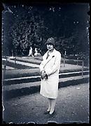 woman standing in a public garden France circa 1920s