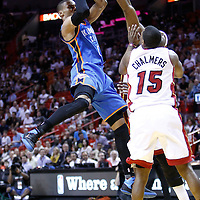 16 March 2011: Oklahoma City Thunder point guard Russell Westbrook (0) takes a jumpshot during the Oklahoma City Thunder 96-85 victory over the Miami Heat at the AmericanAirlines Arena, Miami, Florida, USA.