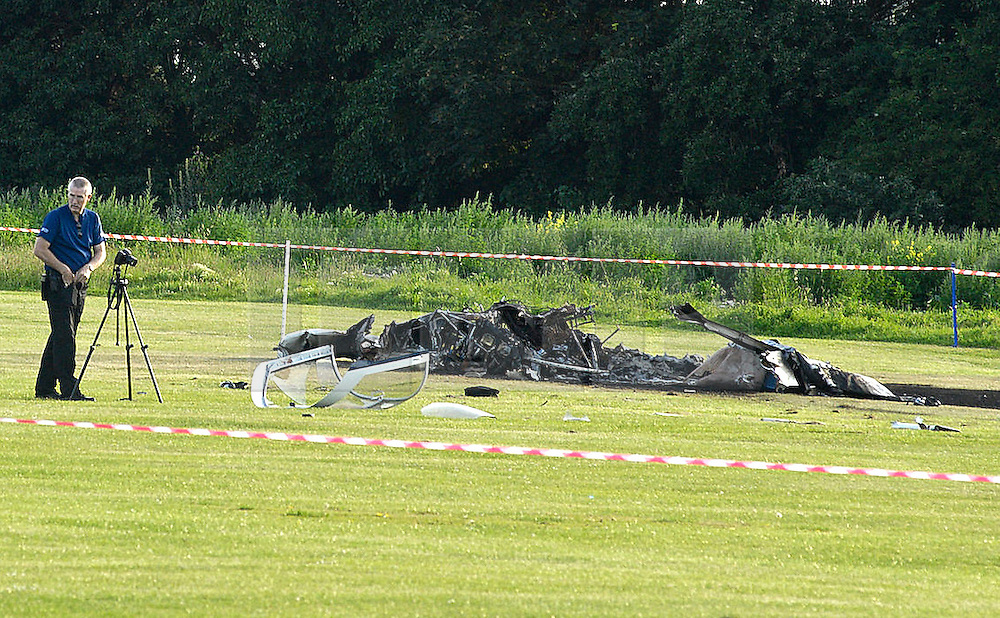 © licensed to London News Pictures. SHOREHAM, UK  04/07/11. The wreckage of a plane. One person is believed to have died after a light aircraft collided mid-air with another plane above an airport today. The incident was reported close to Shoreham Airport, near Brighton, West Sussex, at around 4.28pm, Sussex Police said.. Please see special instructions for usage rates. Photo credit should read JULIE EDWARDS/LNP