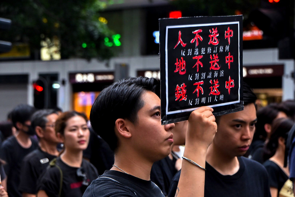 A protester exhibits his sign during June protests in Hong Kong opposing a controversial extradition bill.