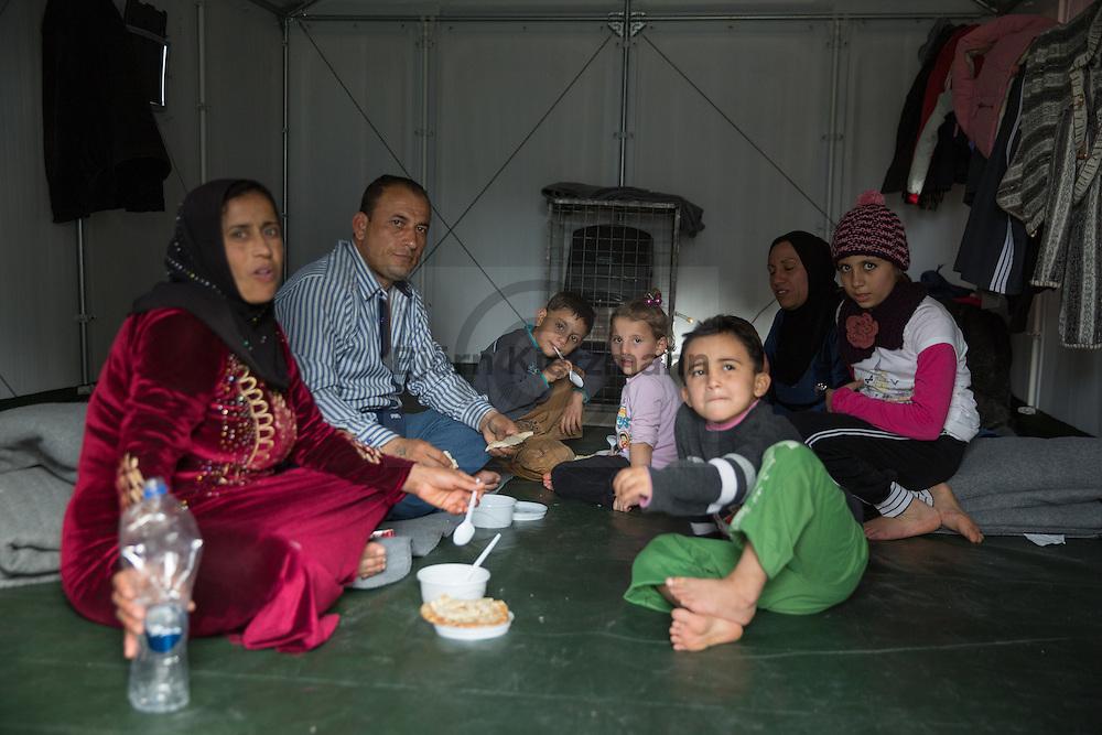 Kara Tepe, Lesvos, Greece - 29.02.2016        <br /> <br /> Kara Tepe refugee camp on the Greek island Lesvos. A Syrian refugee family sitting in a hut, waiting to be able to rely on the authorization the island<br /> <br /> Kara Tepe Fluechtlingslager auf der griechischen Insel Lesbos. Eine syrische Fluechtlingsfamilie sitzt in einer Huette und wartet auf die Genehmigung die Insel verlassen zu duerfen<br />  <br /> Foto: Bjoern Kietzmann