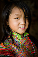Vietnam, Bac Ha. Portrait of a Flower Hmong girl.