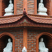 Statues of Buddha at Tran Quoc Pagoda on a small island on West Lake (Ho Tay). Originally built in the 6th century on the banks of the Red River, a changing course of the river forced the pagoda to be relocated in 1615 to Golden Fish (Kim Ngu) islet on the lake.