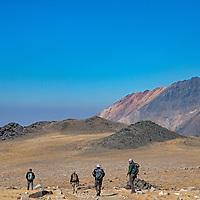 An archaeology team walks toward an ancient village site at 12,400' in Ca;lifornia's White Mountains, the highest Native American settlement in the United States.