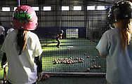 Chester, New York - Young softball wait to take a turn at batting in the cage with the video simulator during the first anniversary open house celebration at The Rock Sports Park on Nov. 12, 2011.