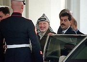 Palestinian leader Yasser Arafat salutes as he leaves the White House following a joint meeting with President Clinton and Israeli Prime Minister Benjamin Netanyahu September 28, 1998 in Washington, DC. Earlier, Israeli diplomats, speaking on condition of anonymity, said there was agreement that Israel would withdraw from an additional 13 percent of the West Bank -- adding to the 27 percent already promised to the Palestinians.