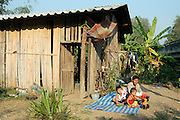 Local home and family on the banks of the river Pai. Pai, is a small town in northern Thailand near the Myanmar border, north of Chiang Mai on the northern route to Mae Hong Son. It lies along the river Pai.