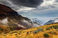 Fog rising to the mountain ridge