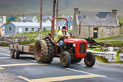 Man on red tractor, Dooagh, Achill Island, County Mayo, Ireland