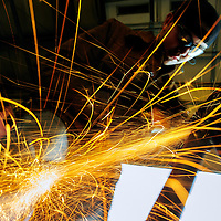 112213  Adron Gardner/Independent<br /> <br /> Sparks fly as Raymond Guardian grinds down a joint weld at Gallup Portable Welding in Gallup Thursday.