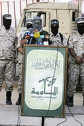 September 26, 2016 - Rafah, Gaza Strip, Palestinian Territory - Palestinian militants from the Al-Nasser Brigades, an armed wing of the Popular Resistance Committees (PRC), take part during a rally in Rafah in the southern Gaza Strip on September 26, 2016, to mark the 17th anniversary of the creation of their group  (Credit Image: © Abed Rahim Khatib/APA Images via ZUMA Wire)