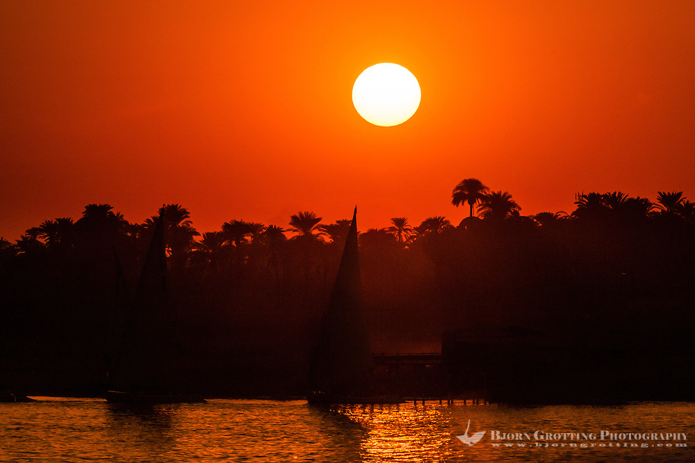 Luxor, Egypt. The sun sets over the Nile. Looking at the West Bank from the East Bank.