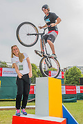 Stunt cyclist Andrei Burton with double Olympic gold medallist Laura Trott watches.  Prudential RideLondon a festival of cycling, with more than 95,000 cyclists, including some of the world's top professionals, participating in five separate events over the weekend of 1-2 August.