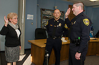 Ann Kaligian swears in Detective Sergeant Thomas Swett with Chief Adams during Thursday afternoon's Laconia Police Commissioners meeting at City Hall.  (Karen Bobotas/for the Laconia Daily Sun)
