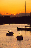 """Annapolis, Maryland-- Sailboats mored on Spa Creek at sunset enjoy safe harbor from the winds of the Chesapeake Bay. Annapolis, with its close proximity to the bay is known as the """"Sailing Capital of the World""""."""