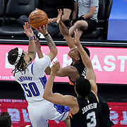 ORLANDO, FL - APRIL 12: Cole Anthony #50 of the Orlando Magic attempts a shot in front of Devin Vassell #24 of the San Antonio Spurs and Keldon Johnson #3 of the San Antonio Spurs during the first half at Amway Center on April 12, 2021 in Orlando, Florida. NOTE TO USER: User expressly acknowledges and agrees that, by downloading and or using this photograph, User is consenting to the terms and conditions of the Getty Images License Agreement. (Photo by Alex Menendez/Getty Images)*** Local Caption *** Cole Anthony; Devin Vassell; Keldon Johnson