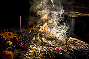 """29th January 2015, New Delhi, India. Incense left by believers smokes in the ruins of Feroz Shah Kotla in New Delhi, India on the 29th January 2015<br /> <br /> PHOTOGRAPH BY AND COPYRIGHT OF SIMON DE TREY-WHITE a photographer in delhi. + 91 98103 99809. Email:simon@simondetreywhite.com<br /> <br /> People have been coming to Firoz Shah Kotla to leave written notes and offerings for Djinns in the hopes of getting wishes granted since the late 1970's. Jinn, jann or djinn are supernatural creatures in Islamic mythology as well as pre-Islamic Arabian mythology. They are mentioned frequently in the Quran  and other Islamic texts and inhabit an unseen world called Djinnestan. In Islamic theology jinn are said to be creatures with free will, made from smokeless fire by Allah as humans were made of clay, among other things. According to the Quran, jinn have free will, and Iblīs abused this freedom in front of Allah by refusing to bow to Adam when Allah ordered angels and jinn to do so. For disobeying Allah, Iblīs was expelled from Paradise and called """"Shayṭān"""" (Satan).They are usually invisible to humans, but humans do appear clearly to jinn, as they can possess them. Like humans, jinn will also be judged on the Day of Judgment and will be sent to Paradise or Hell according to their deeds. Feroz Shah Tughlaq (r. 1351–88), the Sultan of Delhi, established the fortified city of Ferozabad in 1354, as the new capital of the Delhi Sultanate, and included in it the site of the present Feroz Shah Kotla. Kotla literally means fortress or citadel."""