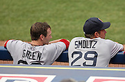 ATLANTA - JUNE 28:  Shortstop Nick Green #22 and pitcher John Smoltz #29 of the Boston Red Sox, both formerly of the Atlanta Braves, watch the action on the field from the dugout during the game against the Atlanta Braves at Turner Field on June 28, 2009 in Atlanta, Georgia.  The Braves beat the Red Sox 2-1.  (Photo by Mike Zarrilli/Getty Images)
