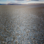 The dry, cracked lake bed bakes under the mid-day sun on the Alvord Desert in south central Oregon