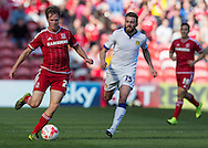 Middlesbrough FC defender Tomas Kalas drives forward  chased by Leeds United FC midfielder Stuart Dallas   during the Sky Bet Championship match between Middlesbrough and Leeds United at the Riverside Stadium, Middlesbrough, England on 27 September 2015. Photo by George Ledger.