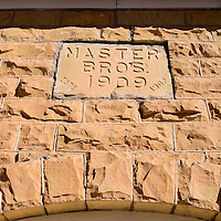 020515       Cable Hoover<br /> <br /> An inscription over the door of the Master Brothers' Store in Ramah shows the year it was built and the year the company was established.