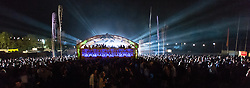© Licensed to London News Pictures. 04/09/2014. Isle of Wight, UK.Thtousands of  festival goers are lit up by strobe lighting as they dance to DJ's at Bestival 2014 Day 1.  The weather has been warm and sunny. Photo credit : Richard Isaac/LNP