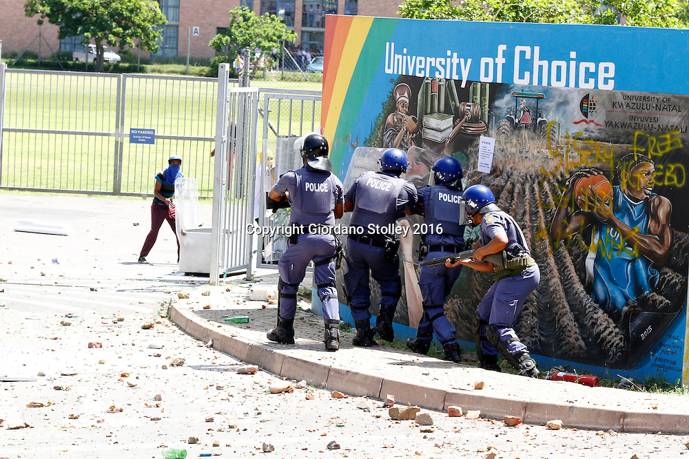 DURBAN - 10 October 2016 - Police officers face off against stone throwing students at the University of KwaZulu-Natal's Westville campus. South Africa's tertiary institutions have been gripped by ongoing protests against university fees and a host of other complaints. Picture: Allied Picture Press/APP