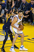 Golden State Warriors center Zaza Pachulia (27) snags a rebound against the Utah Jazz at Oracle Arena in Oakland, Calif., on December 27, 2017. (Stan Olszewski/Special to S.F. Examiner)
