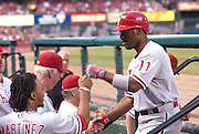 22 June 2011             Philadelphia Phillies shortstop Jimmy Rollins (11) fist-bumps teammates in the dugout after hitting a solo home run in the fourth inning.  The St. Louis Cardinals hosted the Philadelphia Phillies in the second game of a three-game series on Wednesday June 22, 2011 at Busch Stadium in downtown St. Louis.