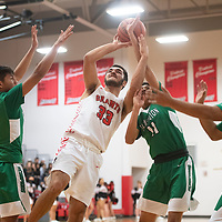 Grants Pirate Adrian Ortega (33) is fouled as he drives to the basket against Farmington Scorpions during the Eddie Peña Classic Basketball Tournament in Grants Thursday.