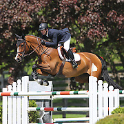 Mclain Ward riding Troya Retiro in action during the $100,000 Empire State Grand Prix presented by the Kincade Group during the Old Salem Farm Spring Horse Show, North Salem, New York,  USA. 17th May 2015. Photo Tim Clayton