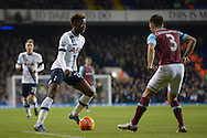 Joshua Onomah of Tottenham Hotspur (l) looks to go past  Aaron Cresswell of West Ham United . Barclays Premier league match, Tottenham Hotspur v West Ham Utd at White Hart Lane in London on Sunday 22nd November 2015.<br /> pic by John Patrick Fletcher, Andrew Orchard sports photography.