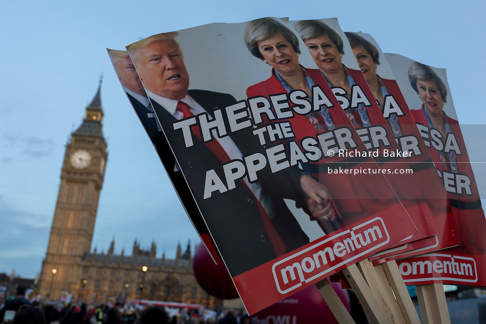 "As the British government debated US President Donald Trump's state visit to the UK, thousands of protesters gathered in large numbers against the trip which would potentially cost millions of Pounds in security alone, on 20th February 2017, in Parliament Square, London, UK. The visit comes after two online petitions received more than the 100,000 signatures required for such a debate to be considered in Parliament. A petition against the state visit got 1.85m signatures, while one supporting it got 311,000. Campaigners protested against the ""hatred, racism and division that Donald Trump is trying to create"". Prime Minister Theresa May announced the state visit during her visit to Washington in January."