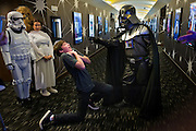 """Sixteen year-old Giovanni Fitzgerald, of Fort Myers, plays the role of one of Darth Vader's victims while arriving for the opening night of """"Star Wars: The Force Awakens"""" at the Silverspot Cinema on Thursday, Dec. 17, 2015, in North Naples.  The theater welcomed Star Wars fans to the opening of the movie with costumed characters and Star Wars-themed cocktails."""