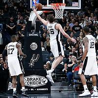 04 April 2017: San Antonio Spurs center Pau Gasol (16) grabs a rebound next to San Antonio Spurs guard Jonathon Simmons (17) during the San Antonio Spurs 95-89 OT victory over the Memphis Grizzlies, at the AT&T Center, San Antonio, Texas, USA.