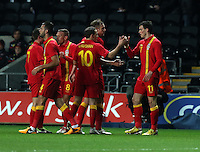 Pictured: Gareth Bale of Wales (R) with team mates  celebrating his opening goal. Wednesday 06 February 2013..Re: Vauxhall International Friendly, Wales v Austria at the Liberty Stadium, Swansea, south Wales.