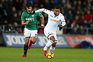 Luciano Narsingh of Swansea city breaks away from Claudio Yacob of West Bromwich Albion.  Premier league match, Swansea city v West Bromwich Albion at the Liberty Stadium in Swansea, South Wales on Saturday 9th December 2017.<br /> pic by  Andrew Orchard, Andrew Orchard sports photography.