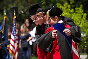 Eric Tjossem '12 shares a hug with his mother and Dean of the College Paula Smith. BEN BREWER/Grinnell College