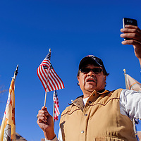 112614       Cable Hoover<br /> <br /> Allen Tsinigine reads aloud a message from Chris Deschene during a protest with Navajo Voter's Rights Coalition Wednesday at the Navajo Council Chambers in Window Rock.
