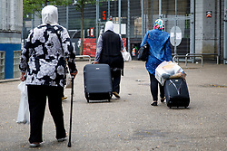 © Licensed to London News Pictures. 01/07/2017. London, UK. Survivors of the Grenfell Tower fire move to their temporary accommodation from the Westway Sports Centre on Saturday, 1 July 2017 in west London. Photo credit: Tolga Akmen/LNP
