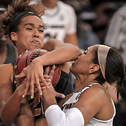 South Carolina Gamecocks player A'ja Wilson is fouled as she drives to the basket by Missouri's Cierra Porter during an SEC women's college basketball game in Columbia, S.C. ©Travis Bell Photography