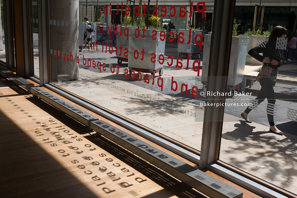 A tribute to National Trust founder Octavia Hill, with a quote of sentences written and appearing on a window and on the floor inside the Royal Festival Hall on London's Southbank.