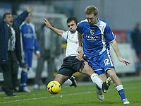 Photo: Aidan Ellis.<br /> Preston NE v Cardiff City. Coca Cola Championship.<br /> 19/11/2005.<br /> Cardiff's Rhys Weston is challenged by Preston's Callum Davidson