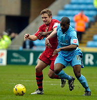 Photo: Ed Godden/Sportsbeat Images.<br />Coventry City v Cardiff City. Coca Cola Championship. 10/02/2007. Coventry's Isaac Osbourne (R), is held off the ball by Stephen McPhail.