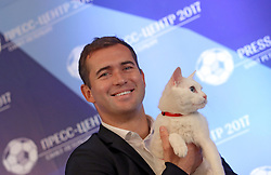 June 15, 2017 - Saint Petersburg, Russia - June 15, 2017. - Russia, Saint Petersburg. - FC Zenit forward Aleksander Kerzhakov presents Achilles the cat who will predict the results of 2017 Confederations Cup matches, at the Confederations Cup press center for non-accredited media. Achilles lives at the State Hermitage Museum in St. Petersburg. (Credit Image: © Russian Look via ZUMA Wire)
